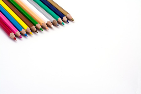 colored backgound: Colored pencils in a line on a white backgound  Stock Photo