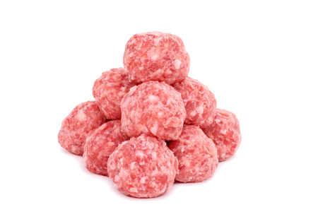 Raw uncooked meatballs on a isolated white background
