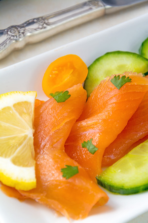 room for text: Selective Focus on Fresh Smoked Salmon placed on a white plate, room for text