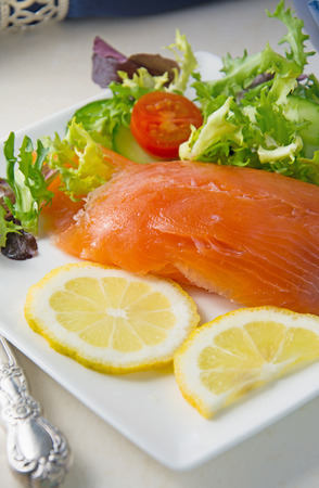 room for text: Selective Focus on Fresh salmon placed on a white plate with salad, room for text