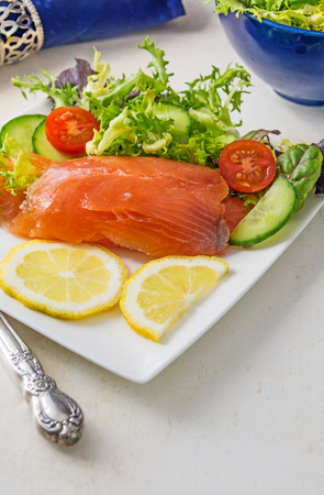 room for text: Selective Focus on Fresh salmon placed on a white plate  with salad  room for text