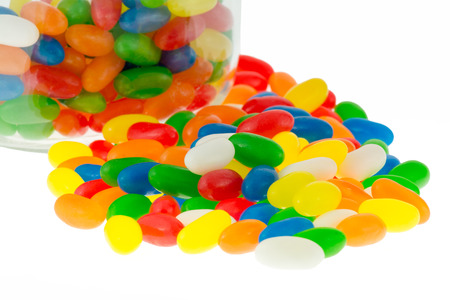 jellybean: Close up of jellybean sweets in a jar on an isolated white background