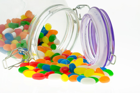 jellybean: Colourful Jellybean sweets from a jar on a white background