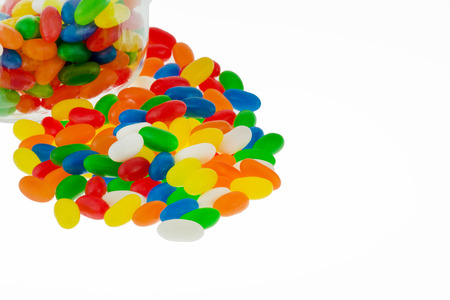 jellybean: Colourful jellybean sweets in a jar isolated on a white background