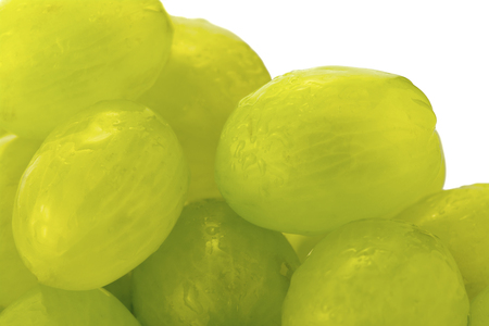 room for text: Selective focus of a Close up showing green fresh Juicy grapes  just washed with a white background, room for text Stock Photo