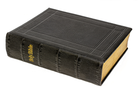 big bible: Large antique holy bible, black leather with gold writing, whith background,