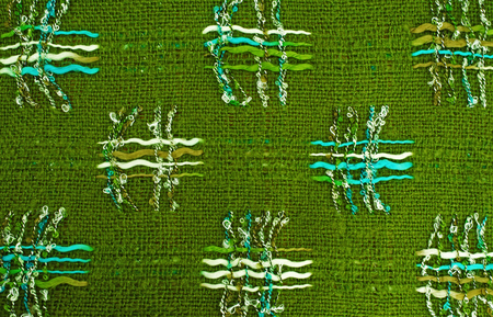 criss cross: Textured background of a criss cross pattern on a green heavy cloth