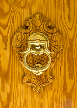 Modern Spanish Brass Door Knocker Mounted On Carving Set On A Pine Front  Door. Stock
