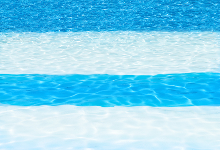 drench: blue and white striped swimming pool background showing cool crystal sun drench water, shot for copy space, backgounds, texts, blog posts the web and posters  Stock Photo