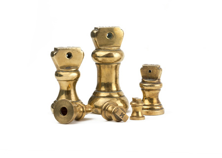 A set of antiques brass imperial weights isolated  on a white background.