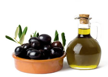 Olive oil with olives on a white background with copy space Stock Photo