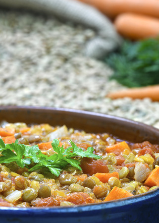 close up vertical shot of Organic lentil and carrot soup home made from fresh ingredients  food placed  in the background with blurred for copy space Archivio Fotografico