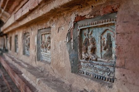 told: Buddhas Life told in reliefs at a temple complex at Bagan Myanmar.