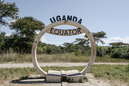 equator: The sign of the equator in Uganda.