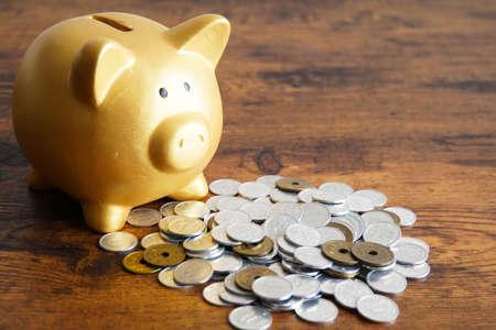 Coin piggy bank pig with Japan Foto de archivo