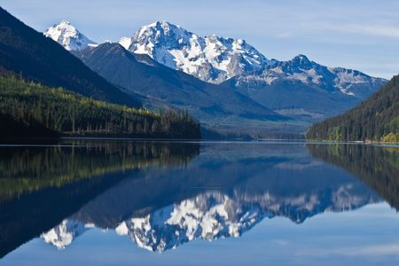 Mountain Range in British Columbia reflecting on a lake Stock Photo