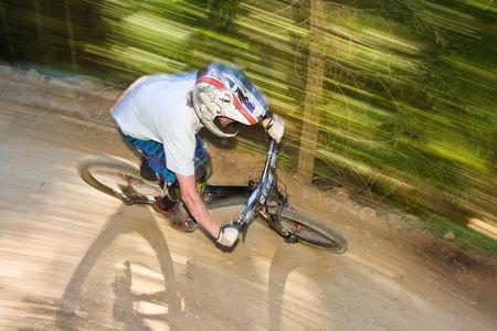 road bike: Mountain biker racing down the trail Stock Photo
