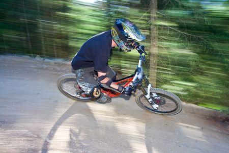 off road biking: Racing Mountain biker in a corner