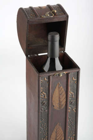 Wood box with one red wine bottle photo