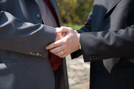 hand cuffs: handshaking Stock Photo
