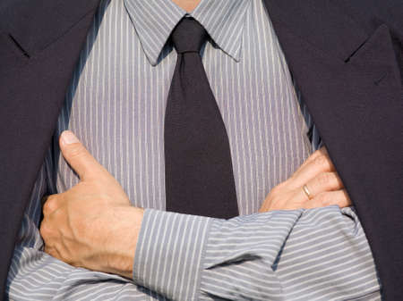 businessman in suit with crossing his hands Stock Photo