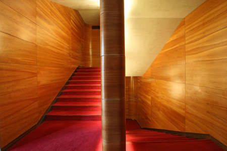 modern stairway, wood wall and red velvet carpet photo