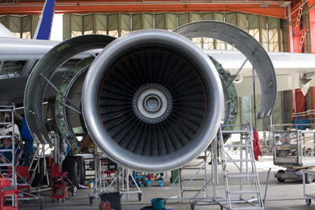opened aircraft engine in the hangar