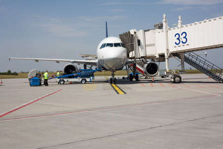 aircraft on the ground, getting loaded Stock Photo