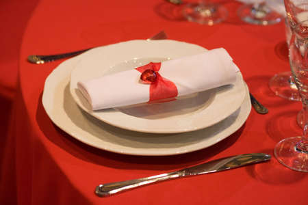 Elegant place setting with red heart photo