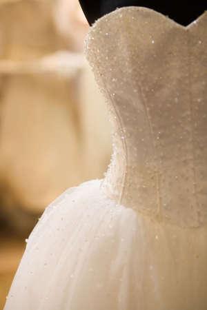 white bride costume on shop mannequin photo