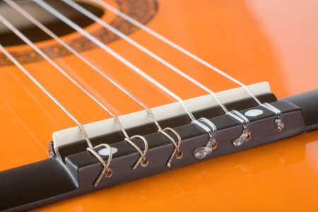 Acoustic guitar bridge and strings close up Stock Photo