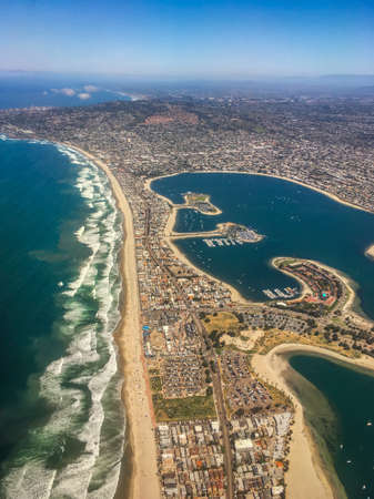 Vibrant, High Altitude Aerial Photo of the Coast of San Diego, California - with a View of the Ocean, Beach, City and Bay on a Bright, Clear, Sunny Day
