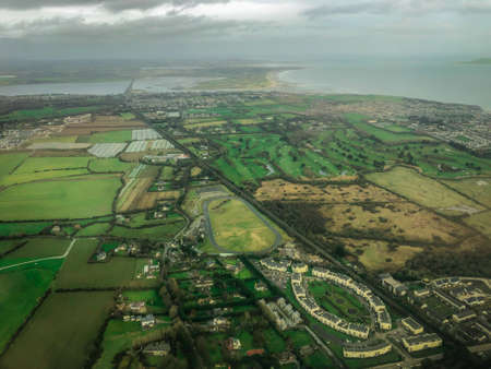 Aerial Flyover View of the Western Countryside and Coast of Ireland - with Green Pastures, Blue Seas and Cloudy Skies Banco de Imagens