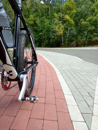 Bike on bicycle lane symbol. Road to work. Travel concept