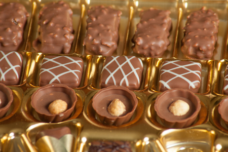 a lot of variety chocolate pralines for sweet life Stock Photo