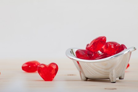 Plastic Red heart on wooden background Stock Photo