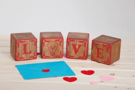 LOVE write in wooden alphabet block on bright board background. Love concept or valentine day Banque d'images