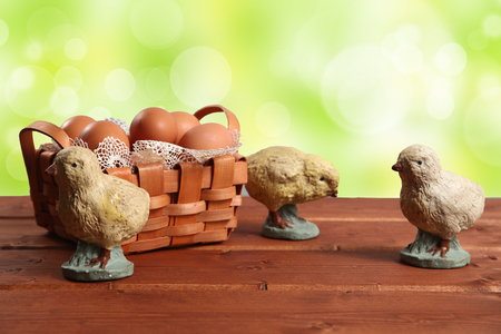 Easter chikens on wood background