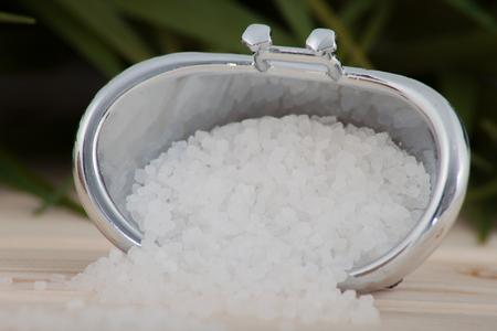 Natural bath salt, organic products on leaves background. Reklamní fotografie