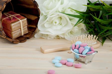 Bath Time color tablets for kids on wood background Banque d'images