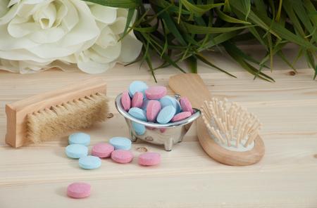 Bath Time color tablets for kids on wood background Reklamní fotografie