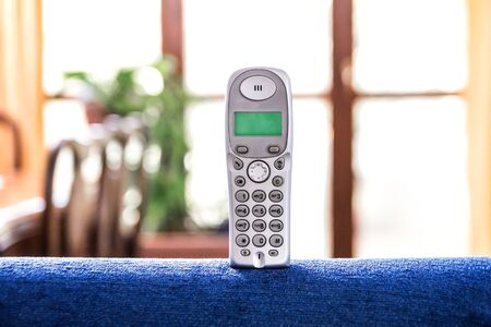 sof: cordless phone on a blue sof Stock Photo
