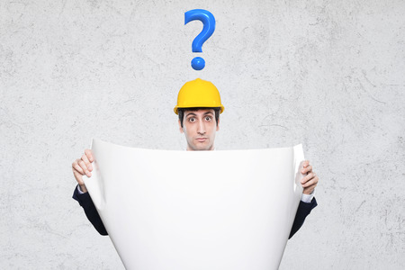 entrepeneur: entrepeneur with many questions with project in hand Stock Photo