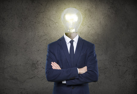 business man  with light bulb head on background photo