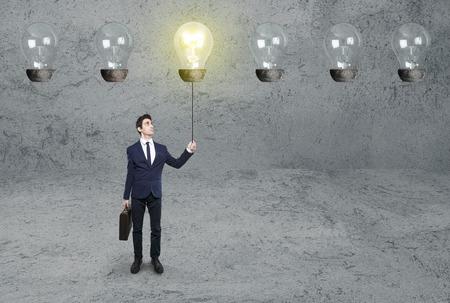 bulb light on business man on dark background photo