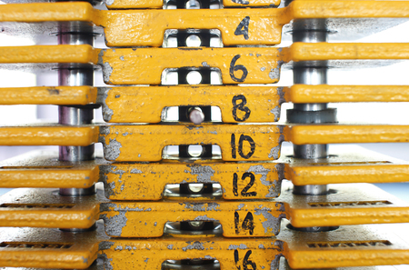 kilos: Close up of weights in a gym with the pin.