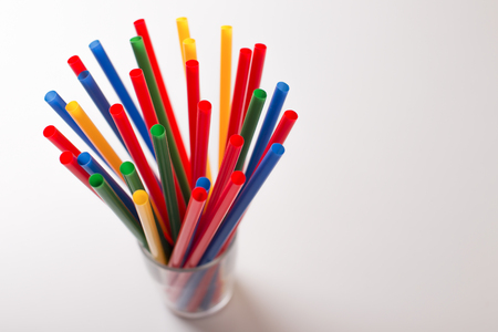 Multi Color flexible straws isolated on background. photo