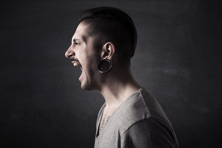 male face profile: portrait of angry man screaming