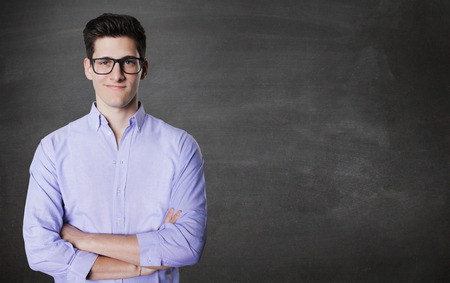 Closeup portrait, handsome excited, energetic, happy, smiling student man . Stock Photo