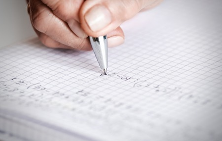 write: soft focus pen writing by female hand. Stock Photo